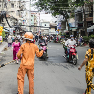 Worker sweeping the street in Ho Chi Minh City